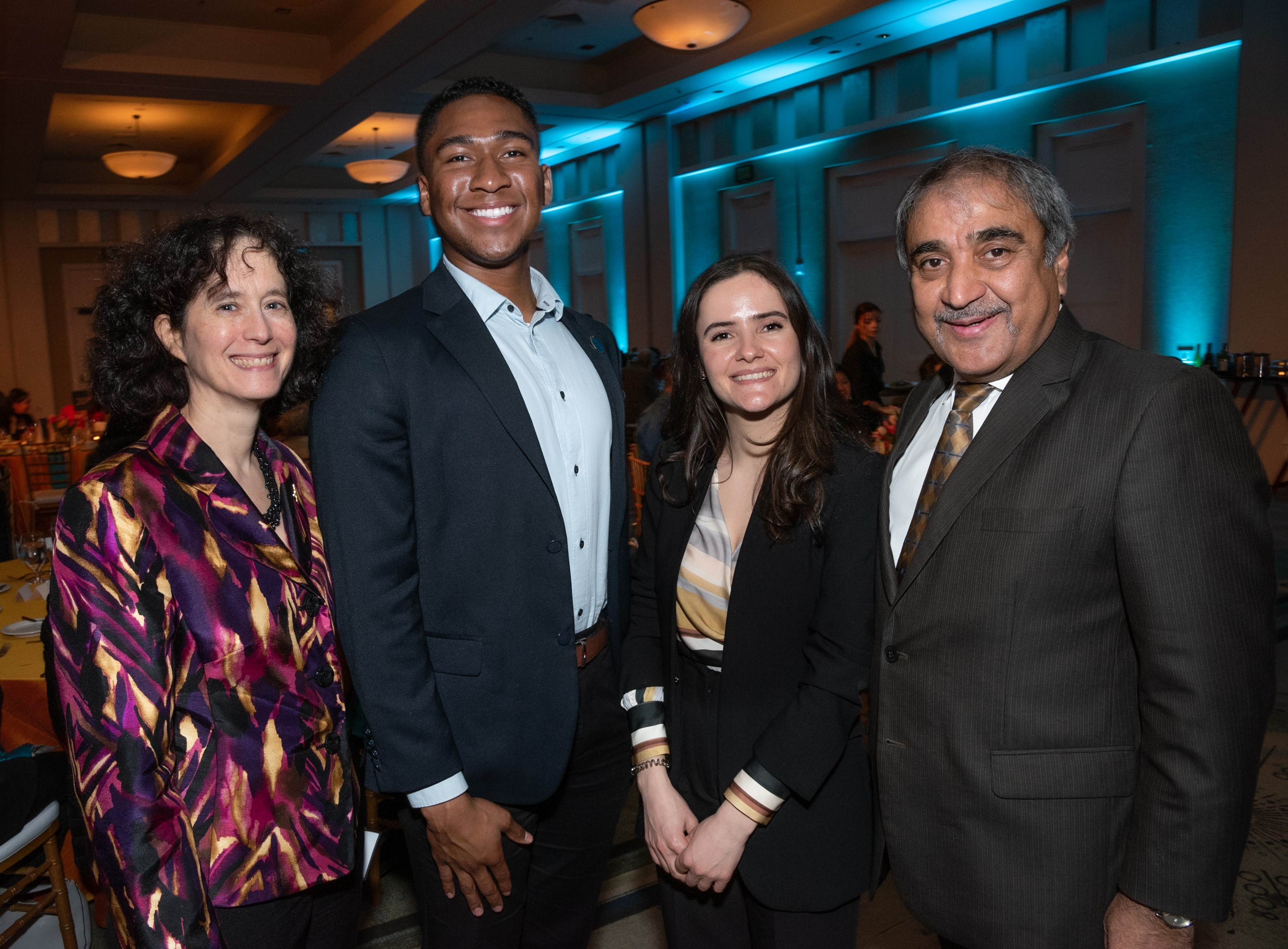 Executive Vice Chancellor Elizabeth Simmons; David Anyakora, Revelle College '22; Albana Bakaj, Eleanor Roosevelt College '20; and Chancellor Khosla at the 2020 Hearts and Scholars Dinner