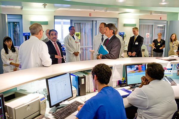 Chancellor Khosla and CEO Paul Viviano talk with staff at UC San Diego Medical Center in Hillcrest
