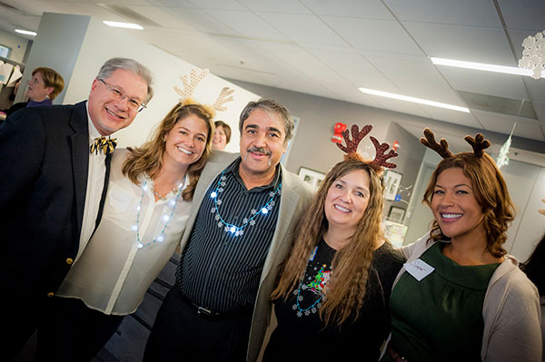 Chancellor Khosla enjoys a moment at the Division of Arts and Humanties holiday reception.